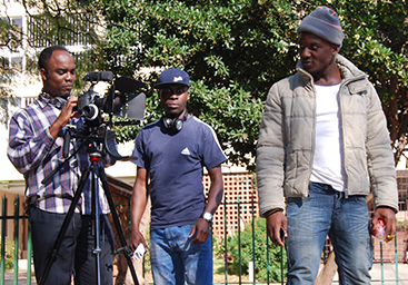 QUIET ON SET! Star and producer Joe Kazadi, director Cedric Wembe and the cinematographer on set prepping for a scene for the low budget student film The Missing Link.                              Photo: Provided