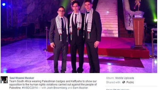 The photograph posted to Facebook showing Broomberg and two others wearing Palestinian badges and Kaffeiyrs (scarves), found on the petition started by Concerned Zionist.