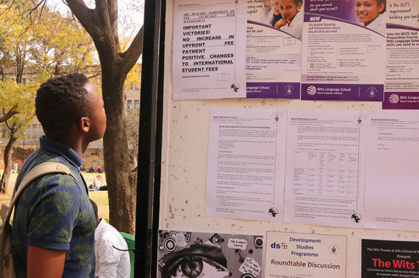 Posters claiming the fees negotiations are 'Important Victories!' are stuck up all over campus. Photo: Roxanne Joseph