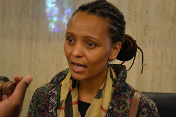Asanda Benya, a sociology researcher and Phd student speaking on women in Marikana. Photo: Percy Matshoba