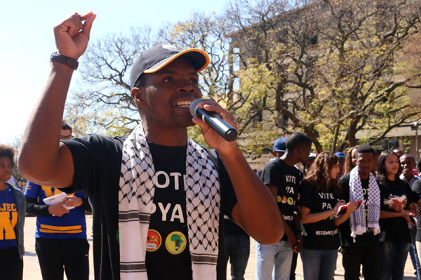 """TRIED & TESTED: Progressive Youth Alliance (PYA) candidate Mcebo Dlamini convincing students to vote for the """"very same leadership that has been with you through thick and thin"""". Dlamini assured students that no amount of insults will take away the PYA from students. Dlamini was addressing a crowd of students at one of the  lunch circuses held outside the  Wits Great Hall. Photo: Nqobile Dludla"""