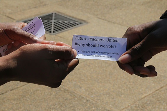 WHY VOTE: A student on Education Campus passing on flyers to make others think twice before they vote.     Photo: Bongiwe Tutu