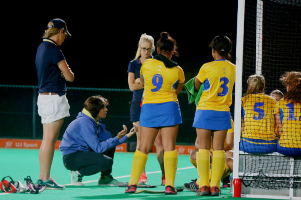 BACK TO THE DRAWING BOARD: Wits coach (kneeling down) Pietie Coetzee strategizing a new plan