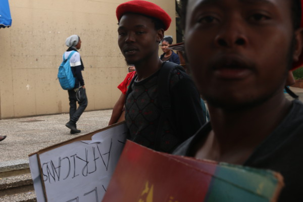 DE WET'S FINAL ATTEMPT: The last photograph taken outside the Matrix before EFF supporters tried to take a camera from a Wits Vuvuzela reporter.  Photo: Anlerie De Wet