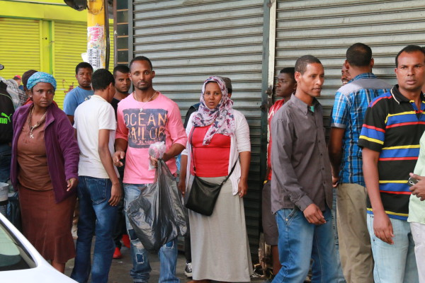 Shop owners on Jeppe Street locking up their businesses in fear of xenophobic attacks in Johannesburg on April 15, 2015. Photo: Reuven Blignault