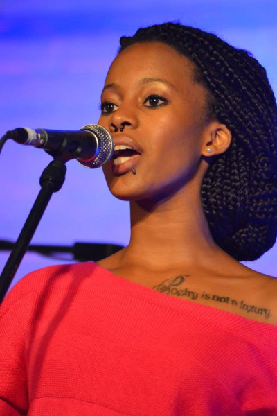 Nova on the mic: Lebohang 'Nova' Masango  is a believer in the power of words; she can be seen devoting her words on stage with her healing and emotionally charged poems. Photo: Provided