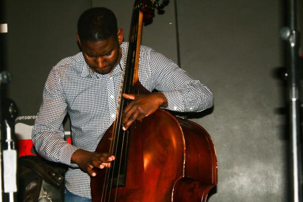 Double bassist, Thembinkosi Mavimbela playing tunes from Sisa Sopazi's debut album, Images and Figures at the Orbit. Photo: ZImasa Mpemnyama