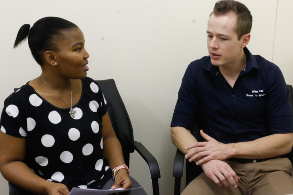 THE ROAD TO SUCCESS: Danie De Klerk, coordinator of the Road to Success Programme, and Masego Modise, a Law tutor on the programme discuss how work is assessed in the Law School. Photo: Riante Naidoo.