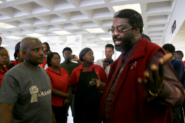 DEAL OR NO DEAL: Campus Control 's Michael Mahada arrived at the dining hall to receive the worker's memorandum but workers refused for their representative, Vusi Masondo to hand it over to him, insisting that Royal Mnandi manager Analene Coetzer come and address them directly. Photo: Michelle Gumede