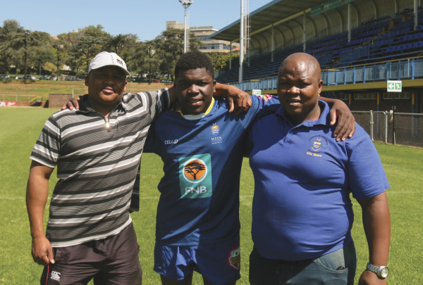 Abdul Mayimele with his coaches