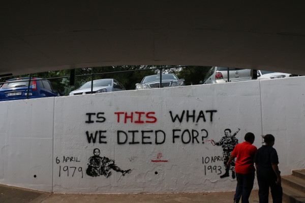 IS THIS WHAT WE DIED FOR: Grafitti remembering the deaths of anti-apartheid activists Solomon Mahlangu and Chris Hani Photo: Lwandile Fikeni