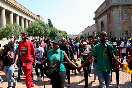 FREE EDUCATION: Student protesters lined up at the entrance to Empire Road.