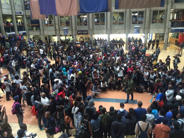 ASSEMBLE: Students begin to organise at Solomon House on Monday following a fees announcement by Minister of Education Blade Nzimande.