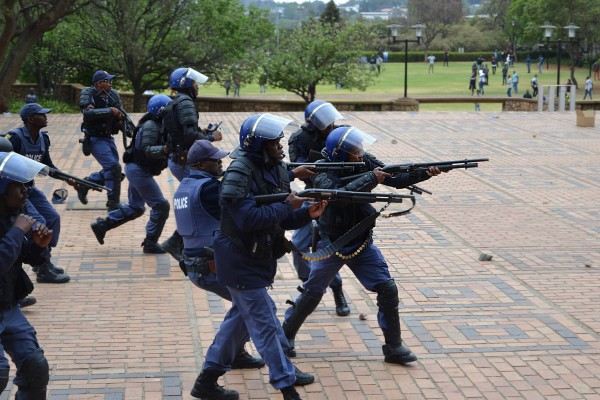Clash between police and students, police advance closer to the crowd of protesting students while rocks were being thrown, rubber bullets were being fired. Photo: Candice Wagener
