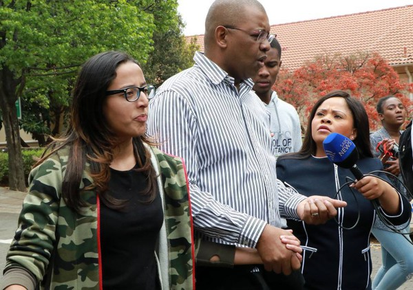 Advocate Dali Mpofu speaks with SABC's Criselda Lewis, right, about his role in calming the police on campus. Photo: Dinesh Balliah.